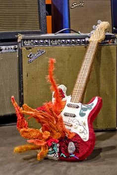 Jimi Hendrix's guitar … um, on fire. Knit by Sarah Stollak #knit #knitting #JimiHendrix