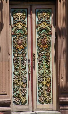 Painted carved wood door. Mexico