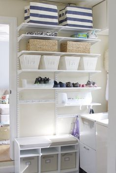 Easy DIY laundry room / mudroom wall created by Simply Organized