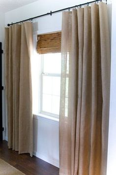 burlap curtains DIY! I think I will try this for the downstairs room.