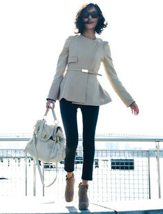 Structured jacket.with a 7/8 slim low boots mulberry bag   fashion glasses an beautifull and dynamised short hair   for a fashion buisness wooman