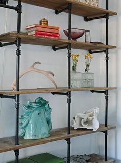 """The pipe shelf is my favorite feature of this room. The wall was empty when we moved in, my husband and friend came up with the great idea o..."""