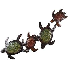 These turtles aren't so slow. Made of iron, they're designed to display indoors or out, where they add instant fun to a sunroom, garden wall, patio or pool-side cabana. Cottage Porch, Turtle Love, Unique Wall Art, Pier 1 Imports, Beach Themes, Beach Ideas, Accent Decor, Climbing, Wall Decor
