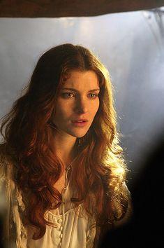 Reddish brown hair, blue eyes, startled, nightdress