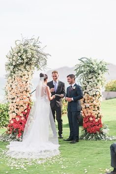Outdoor wedding ceremony decorations with floral installation | Romantic  picture of bride and groom  - Photography: JBJ Pictures | Colorful Cabo Destination Wedding - Belle The Magazine Event Photography, Sunset Photography, Best Bride, Dream Wedding, Wedding Day, Wedding Ceremony Decorations, Wedding Reception, Classic Blue Suit, Honeymoon Spots