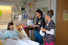 Patient Joyce Casey confers with nurses Elizabeth Tran and Mica Toyota during a nursing shift...