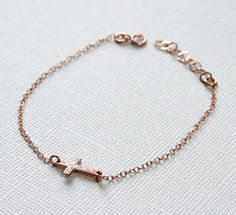 SMALL CROSS SIDEWAYS Bracelet (Sterling Silver-Rose Gold Plated) 012. $20.00, via Etsy.