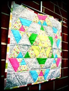 """This newsprint quilt hangs in Craftsy's office and it is FABULOUS. It was made by Sarah Fielke who teaches Craftsy's  """"Big Techniques from Small Scraps"""" class."""