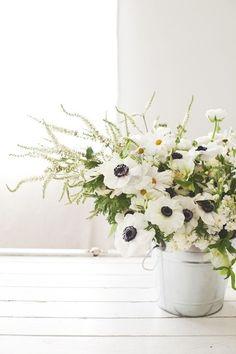 white wedding flower centerpieces in barn | farm inspiration | a fresh centerpiece » i love farm weddings