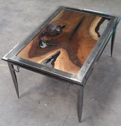 Walnut and metal table with glass top by RensiEcoCreations on Etsy. $650.00, via Etsy.