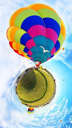 This is a stereographic projection of a 360° panoramic image. This image is of Flecks Folly IV at the 2011 Adirondack Balloon Festival.