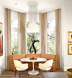 Another example of a window seat (following wall lines) with chairs and a round table)