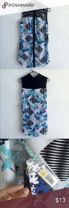NWT Peter Pilotto for Target button down dress NWT dress from the Peter Pilotto for Target collection. Tags and extra buttons included. Dress is lined, size small. Peter Pilotto for Target Dresses