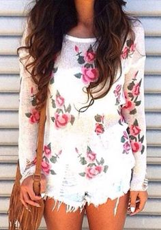 Let your sweet personality shine with this white, rose-printed knit top. The hems of the top and sleeves are asymmetrically ripped to give i...