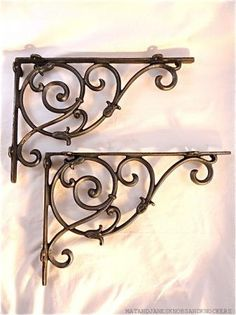 A pair of large cast iron classic Victorian vines brackets