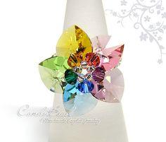 Hey, I found this really awesome Etsy listing at http://www.etsy.com/es/listing/54483589/swarovski-ring-rainbow-heart-swarovski
