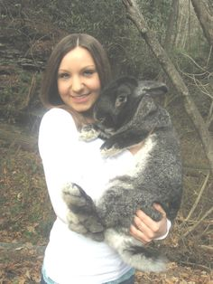 this humongous furball of cuteness is for real! it's a Flemish Giant rabbit and i saw one at the zoo the other day :)