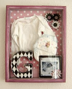 newborn shadow box | 1st picture; newborn diaper; hospital bracelet; outfit worn home from hospital; copy of birth announcement; 1st name initial; etc. | <3