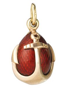 A Fabergé Gold and Enamel Pendant Egg, Workmaster August Holmström, St. Petersburg, circa 1895, the egg enamelled bright strawberry red over an engine-turned ground and contained within anchor form cagework, with suspension ring struck with workmaster's initials and city mark.