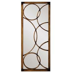 The whimsical Brittany mirror features circular metal overlays. The mirror is finished in a brushed antique bronze metal. Finish: Brushed antique bronze Materials: Metal Dimensions: 47 inches high x 2 Bronze Mirror, Metal Mirror, Wall Mounted Mirror, Circular Mirror, Mirror Mirror, Window Grill Design, Door Design, Glass Design, House Design