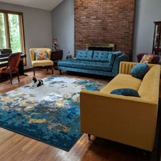 Invite color and abstract pattern into your space with a bold rug that's capable of stealing the show. Living Room Turquoise, Teal Living Rooms, Decor Home Living Room, Colourful Living Room, Living Room Color Schemes, Living Room Sets, Rugs In Living Room, Living Room Designs, Living Room Inspiration