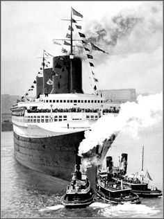 SS Normandie 1935 - flying at the very top of the second mast is the Blue Riband celebrating her record-breaking Atlantic crossing.