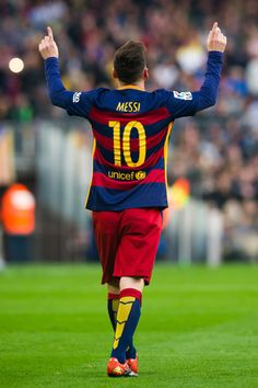 Lionel Messi of FC Barcelona celebrates after scoring the opening goal during…