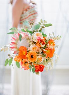 Vibrant pops of orange: http://www.stylemepretty.com/2016/07/14/forget-catching-pokemon-catch-these-wedding-bouquets-instead/