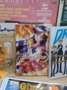 """One of the new """"Sailor Moon"""" manga volumes, on a table with classic manga mags like """"Animerica Extra"""" and """"Smile"""" from the 1990's. Ah, the nostalgia."""