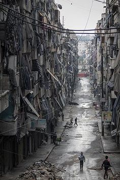 20 Photos: Syrians walk past damaged homes during heavy fighting in Aleppo