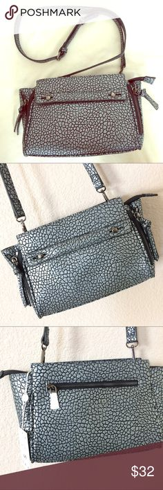 """Urban Expressions metallic crossbody bag Cute and kind of fierce crossbody bag!  Vegan, black and metallic/gunmetal tones.  Zipper closure (always a plus!).  About 11"""" wide, 7"""" tall and 3.5"""" deep, strap drop up to 25"""" (it's buckled at 23"""" in photos and it's good enough for me!  I actually love to wear it on same shoulder rather than as crossbody!).  Make a statement!  NWT! (Orig. $70) Urban Expressions Bags Crossbody Bags"""