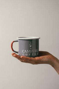 Enjoy our Campfire Coffee in our signature enamel mug. These mugs come from  an European manufacturer who still uses the WWII era machinery. Each steel  mug is coated in hand-dipped enamel. Then the rim and the handle,  the  areas that get the most wear, receive a second dipping of enamel to ensure  strength and durability. Our Campfire logo is baked into the enamel for a  seamless finish and lasting durability.  Please note these mugs are made by hand, resulting in small bits of  character…