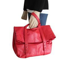 Deleite 05 by SHARO. An oversized large clutch handbag.  Just put your hand through and go. Made of Genuine cows leather. available on ebags, shoebuy, and 11 and main web sites This one in red