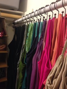 TANK TOP ORGANIZATION: hang shower curtain rod across depth of closet. Hang tanks using shower curtain HOOKS. I can see all my tanks at once and it frees up actual hanging space on closet rod. Plus, I love the look of this....seeing all the colors makes me happy.