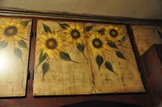 Sunflowers hand painted on kitchen cabinet doors.
