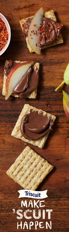 TRISCUIT crackers are now Non-GMO Project Verified and there's so many ways to Make 'Scuit Happen. Get your 'Scuit together with hazelnut spread, sliced pear and sprinkled chili flakes.