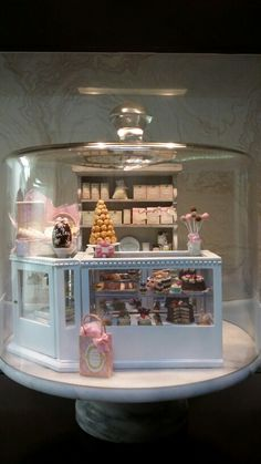 Miniature Bakery fills a marble cake stand , under glass dome.  By Deri Terry