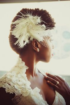 Gorgeous natural hair look for a bride. See more bridal beauty looks: http://ccwed.me/Izo9HA