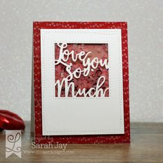 Love You So Much shaker card using Lil' Inker Designs Love You patterned paper, Love You Greeting die, and Silly Stitched die set