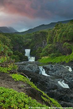 Seven Sacred Pools in Haleakala National Park, Maui, Hawaii. At the Oheo Gulch, also called the Seven Sacred Pools, some 24 waterfalls and natural pools stair-step down into the cobalt blue Pacific Ocean.  The gateway route is the dramatically beautiful Hana Highway on the southeastern Maui coast.