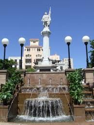 Plaza de Colon, Old San Juan, PR - see that tall building in the back - it's a fantastic HOSTEL - Cannot wait!