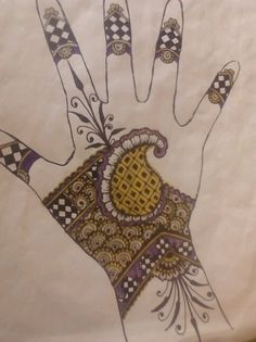 My mehndi design,finished this morning,silver,gold,and purple accents