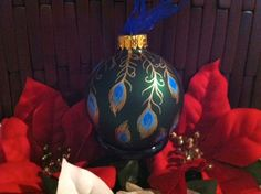 Glass Christmas Ornament Hand Painted Peacock Feathers Ribbon Green. $10.00, via Etsy.