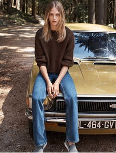 Sasha Pivovarova wears denim pants and sweater in Mango fall style 2015 Photoshoot
