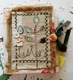 rebecca sower - 7x9 spiral-bound,linen-covered journal A journal with the word listen, buttons, leaves, is so lovely and inspirational.  I should try to make covers for my journals.  Love her style and colors... she's amazing!