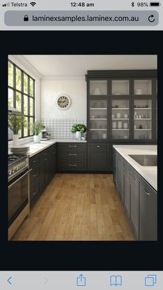 Gray shaker cabinets white quartz counter tops Grecian white marble subway tile and a farmhouse sink are sure to outlast moods and trends