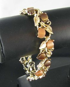 Tan Brown Thermoset Plastic Gold tone cuff by vintagejewelrylane, $19.99