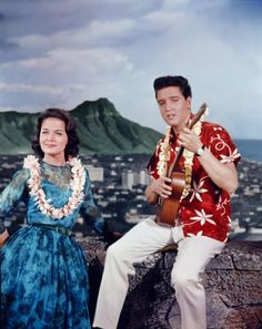 Okay, so this is a picture from the movie Blue Hawaii with Elvis. This was really the only picture I could find with a clear shot of her dress, which I adore.