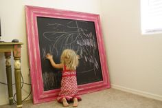 This blog shows how to make this extra large chalk board really cheap.