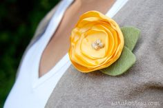 satin flower pin or hair goodie